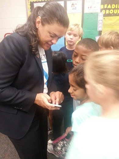 Showing Ms. Dimas' 3rd graders a photo of our Board of Education Chair.